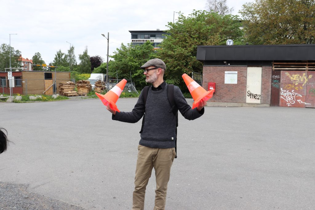 Images shows Trond Magg holding small traffic cones