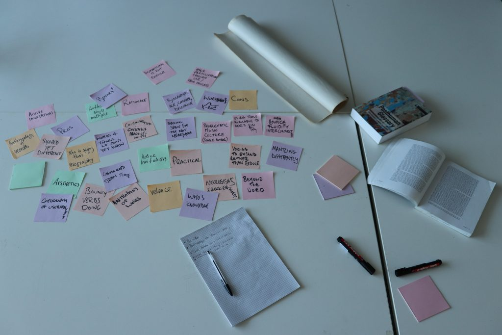 A tabletop with pastel coloured notes discussing ideas around vocabularies.